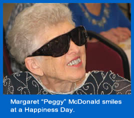 Margaret (Peggy) McDonald smiles at a Happiness Day.