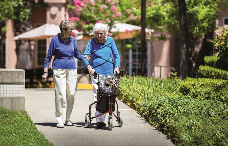 Clea and Jeannie take at walk at Eskaton Village Carmichael